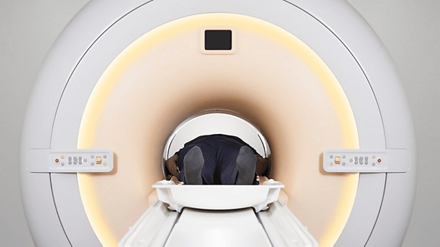 man laying in magnetic resonance machine smartpath