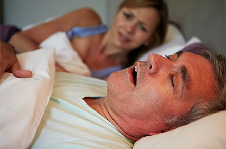 snoring man woman annoyed