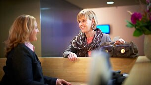 patient talking with reception