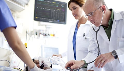 Doctor inspects a patient health in ICU