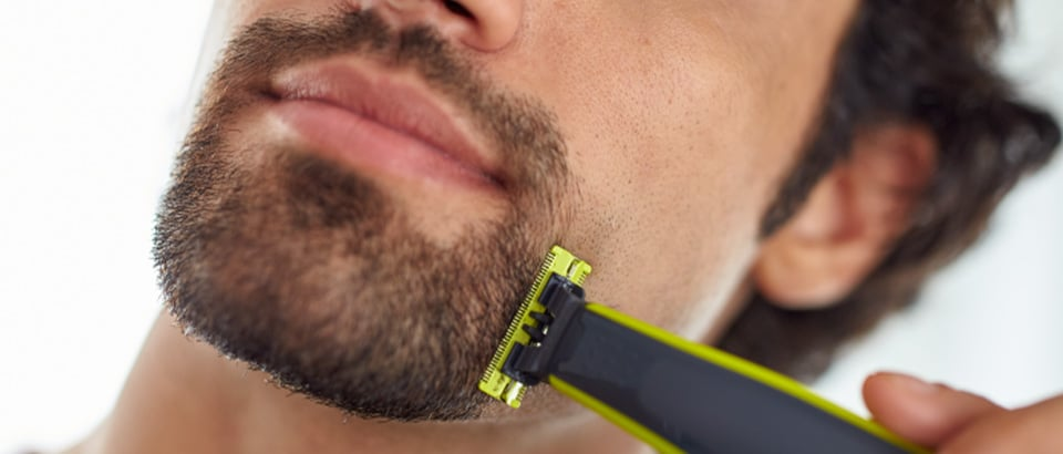 Man trimming stubble with Philips Oneblade