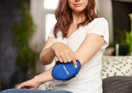 Start your 30-minute psoriasis treatment session with blue LED light by pressing the on/off button on the Philips BlueControl device