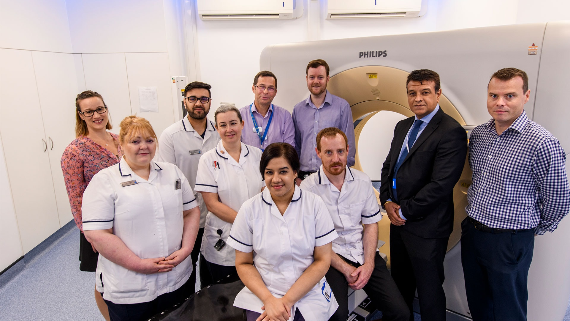 Shown left to right, Hannah Timbrell, Business Marketing Manager, Philips UKI; Helen Corbishley, Pre-treatment Advanced Practitioner; Wasim Ajaib, Senior Radiographer; Sarah Jhally, Pre-treatment Superintendent; Stephen West, Head of Radiography; Doug Northover, Clinical Scientist; Pete Bains, Account Manager and Jon Brigly, Marketing Manager, both of Philips UKI.   Seated in front on the left is Aisha Sajid, Pre-treatment Team Leader and on the right is Joshua Bayley, Pre-treatment Team Leader
