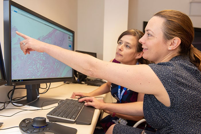 Dr Lisa Browning and Professor Clare Verrill, Honorary Consultant in Cellular Pathology at Oxford University Hospitals working with Philips IntelliSite Pathology Solution's Image Management System
